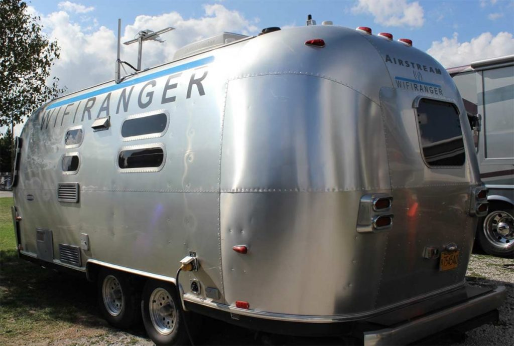 Photo of Kelly Hogan's 23 foot long International Airstream with the WiFiRanger logo across the side.