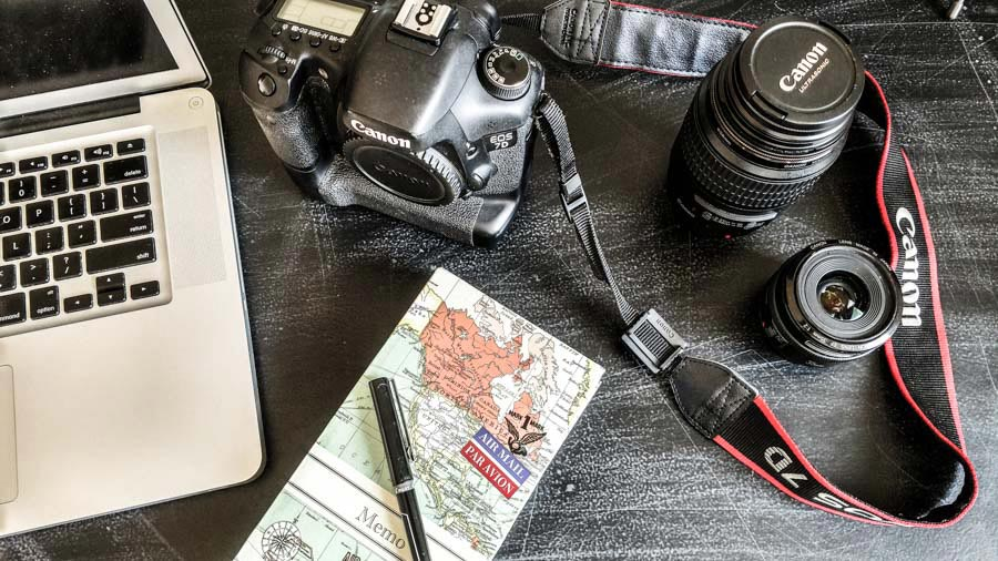 Photo of travel photography equipment and laptop, conveying adventure and excitement.