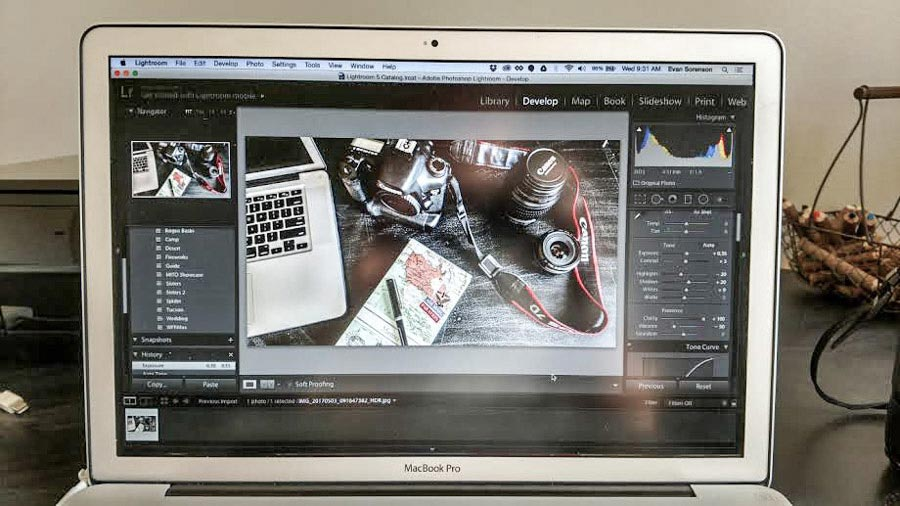 Photo of MacBook Pro editing travel photos in Adobe Lightroom.