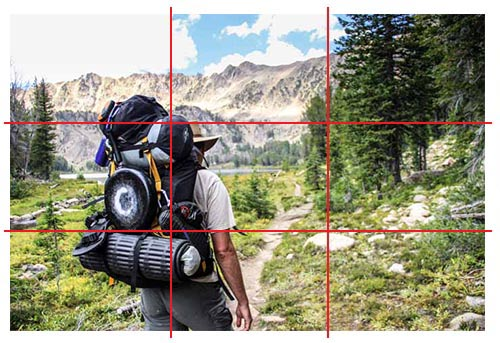 Photo of mountain adventurer hiking with the rule of thirds applied to lines.